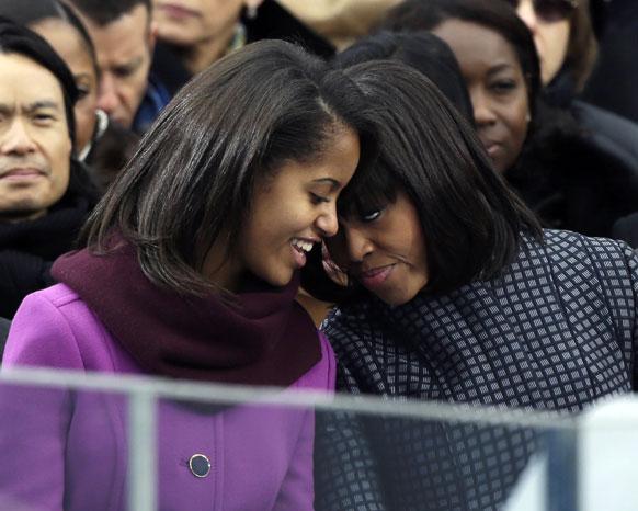 व्हाईट हाऊसमध्ये ओबामांचा अधिकृत शपथविधी सोहळ्याला उपस्थित मायलेकी मिशेल आणि मलिया