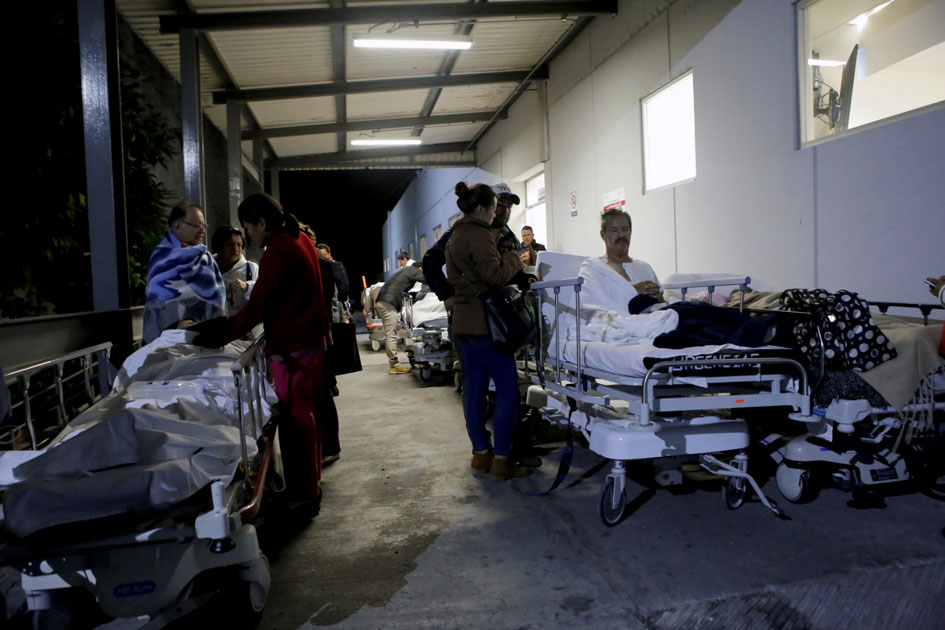Patients and family members are seen outside the ISSSTE after an earthquake