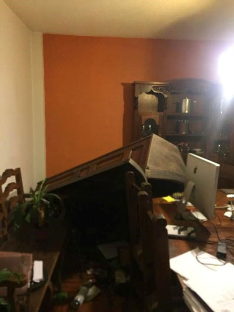 Fallen furniture in an apartment is pictured after an earthquake in Mexico City