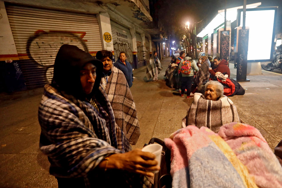 People gather on a street after an earthquake hit Mexico City