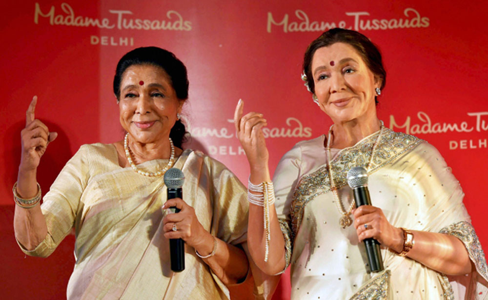 Legendary singer Asha Bhosle poses with her wax-statue during its unveiling, in New Delhi. The statue will be installed at the Madame Tussauds Delhi.