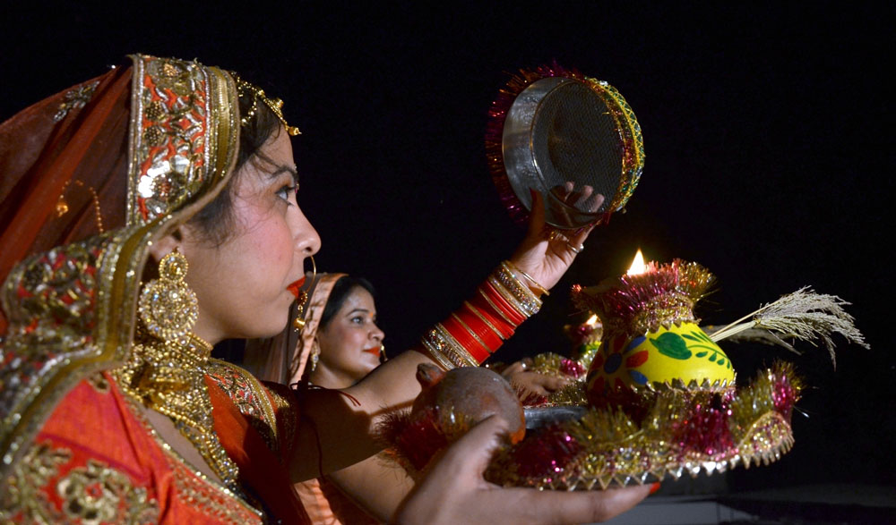 Women celebrate Karva Chauth in Lucknow.