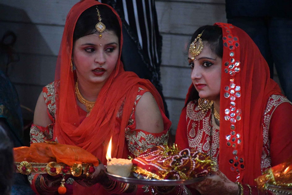 Women perform rituals related to Karva Chauth in Patna