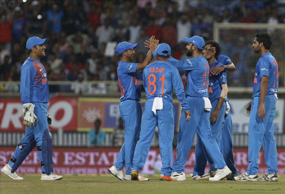 MS Dhoni and Jasprit Bumrah of India celebrate fall of Daniel Christian`s wicket during the first T20 match between India and Australia at JSCA International Stadium in Ranchi.