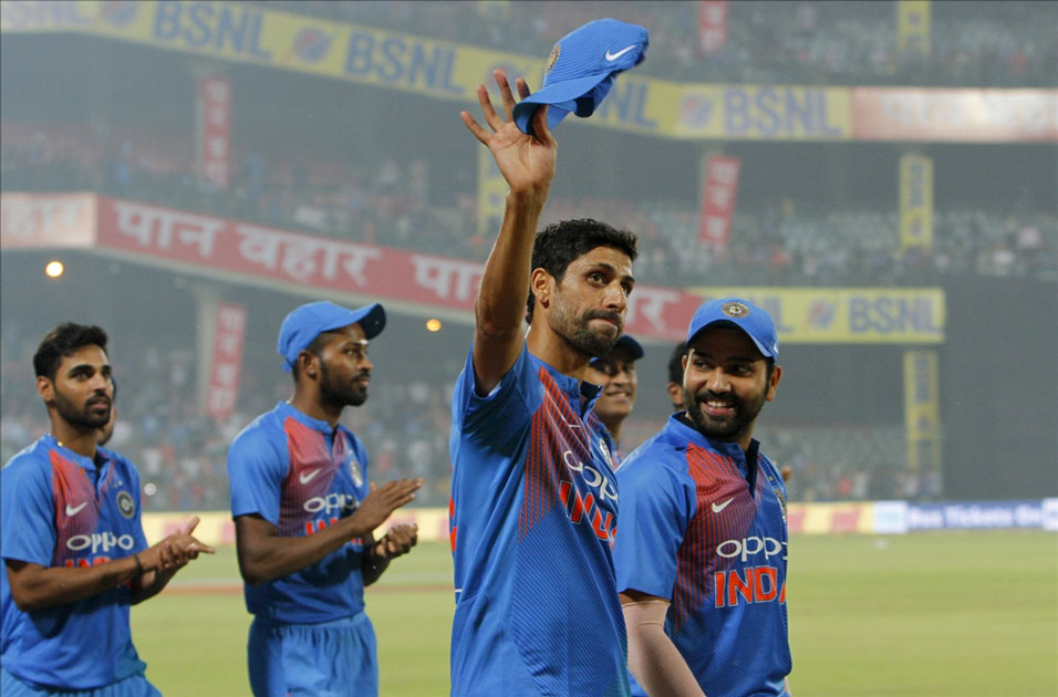 India`s Ashish Nehra along with teammates celebrates after the end of the first T20 match between India and New Zealand at Feroz Shah Kotla stadium in New Delhi.