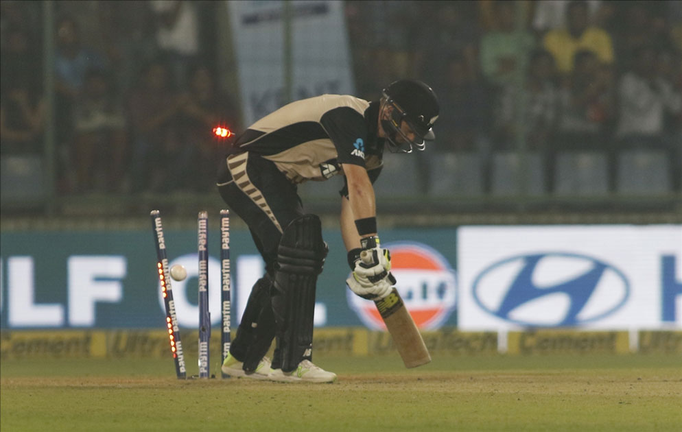 Colin Munro of New Zealand gets dismissed during the first T20 match between India and New Zealand at Feroz Shah Kotla stadium in New Delhi.