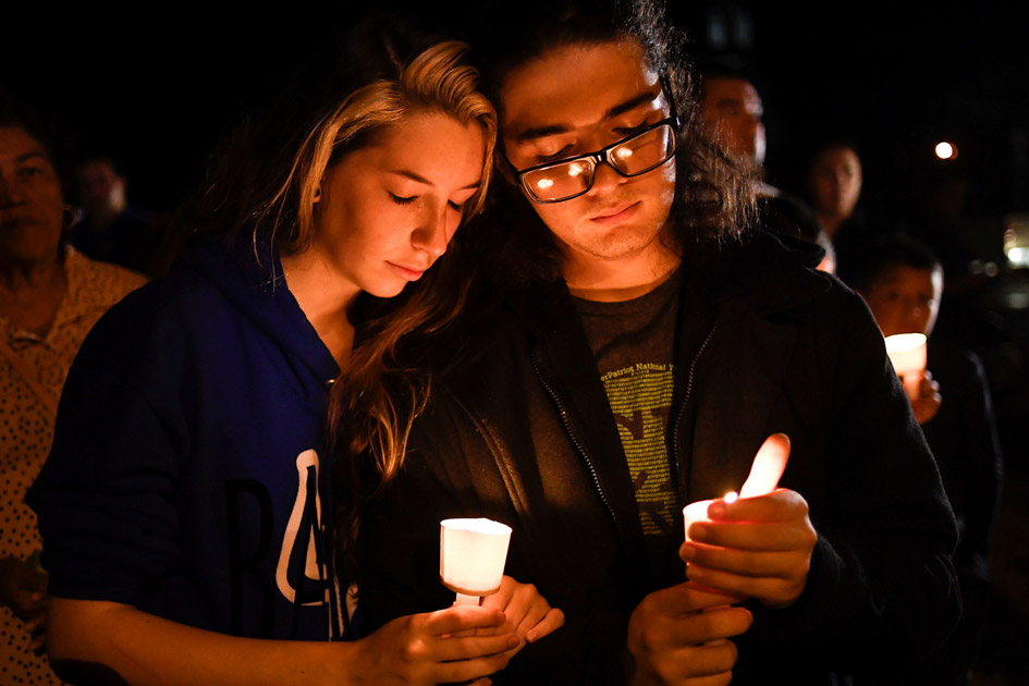 Local residents take part in a vigil for victims of a mass shooting in Sutherland Springs, Texas.