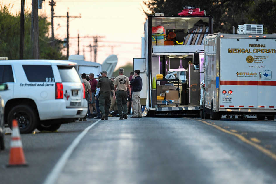 Medical personnel and law enforcement set up along a street near the First Baptist Church in Sutherland Springs, Texas.