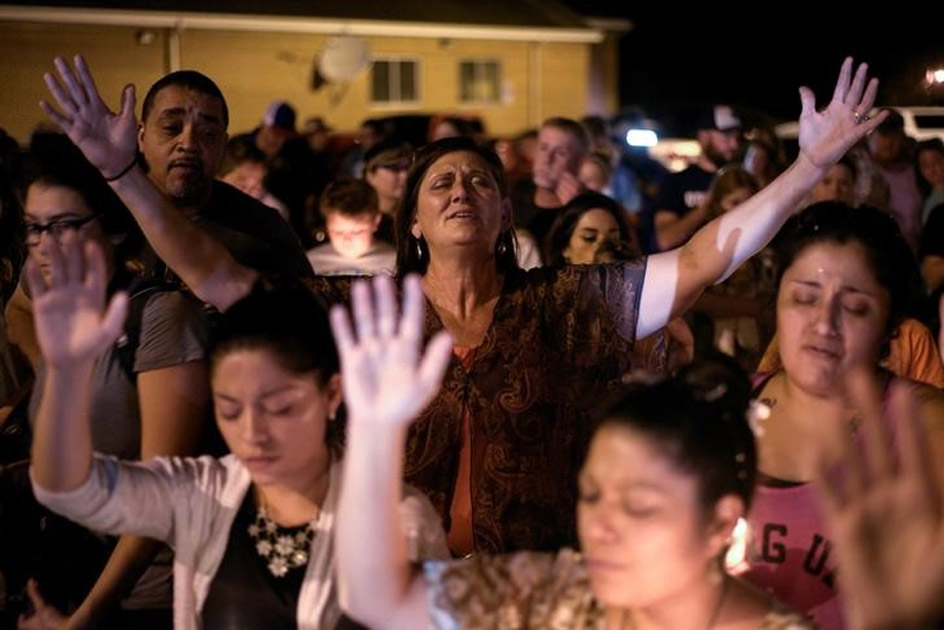 Mourners attend a candle light vigil after a mass shooting at the First Baptist Church in Sutherland Springs.