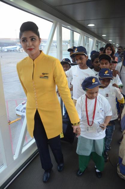 An air hostess with children during