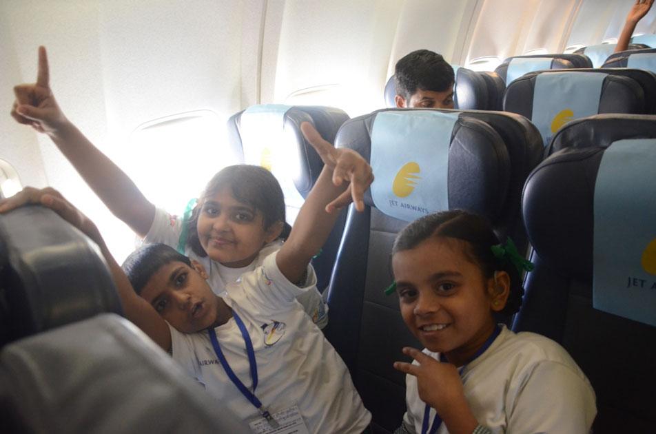 Children inside a Jet Airways aircraft during