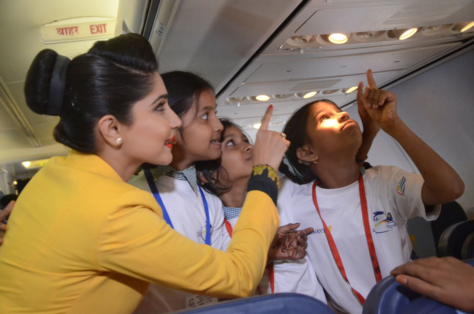 An air hostess with the children during