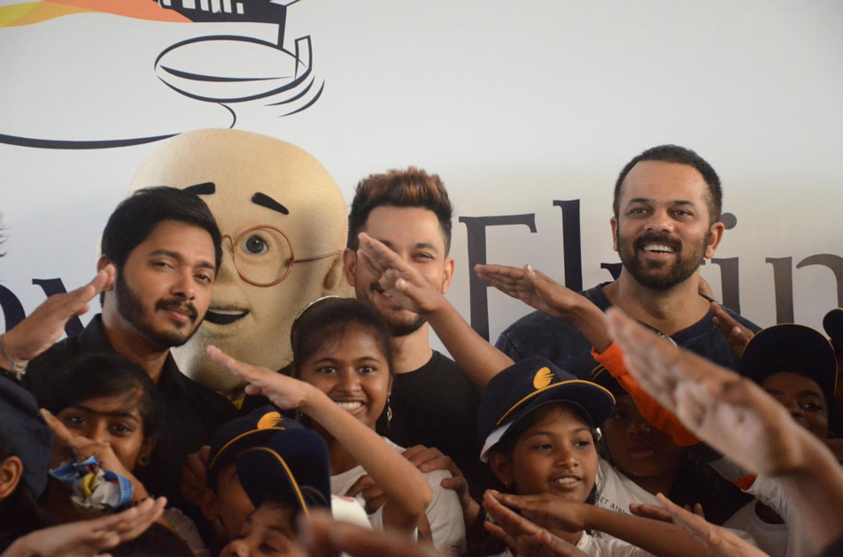 Filmmaker Rohit Shetty and actors Shreyas Talpade and Kunal Khemu with children during a programme organised to announce `Flight of Fantasy` by Jet Airways ahead of Children`s Day at Chhatrapati Shivaji International Airport in Mumbai.