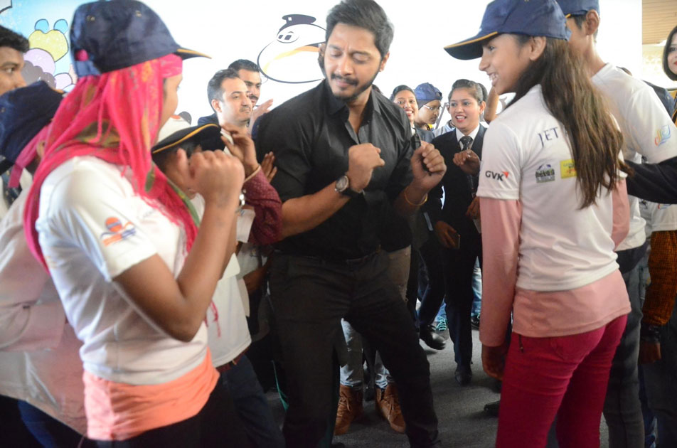 Actor Shreyas Talpade with children during a programme organised to announce `Flight of Fantasy` by Jet Airways ahead of Children`s Day at Chhatrapati Shivaji International Airport in Mumbai.