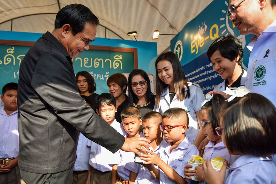 Thai Prime Minister Prayuth Chan-ocha gives presents to kids during a Children`s Day celebration at the Sanam Suea Pa Park in Bangkok, Thailand.