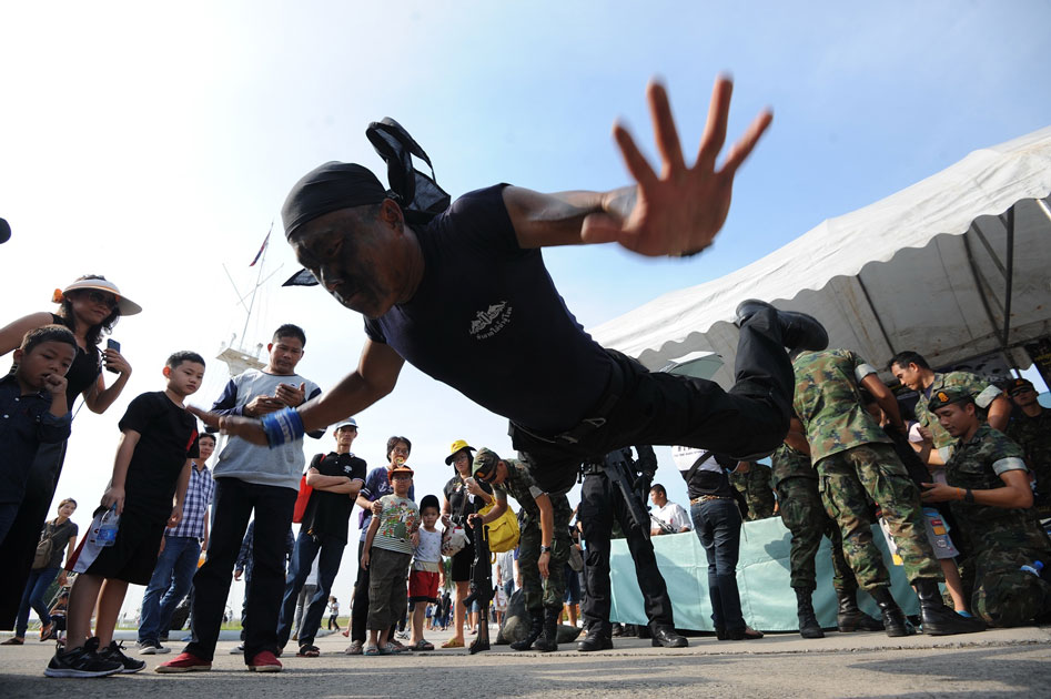 Children and their parents watch a military stunt show during a Children`s Day public-opening event at the Royal Thai Naval Academy in Bangkok, Thailand.