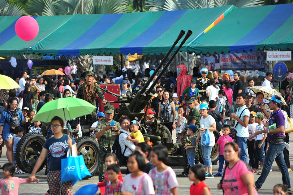 Visitors are seen around an anti-aircraft gun (AA gun) during a Children`s Day public-opening event at the Royal Thai Naval Academy in Bangkok, Thailand.