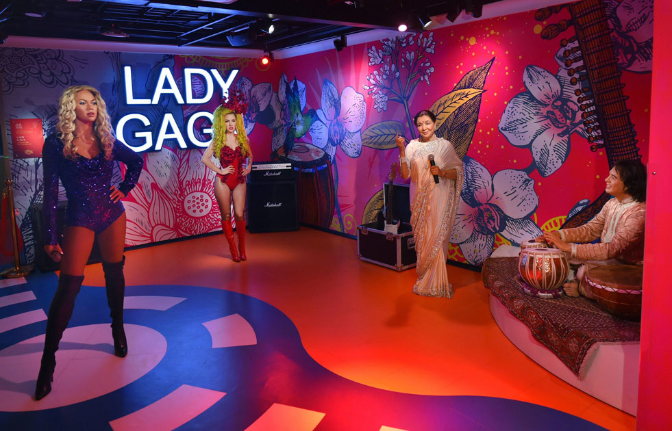 Wax figures of Asha Bhosle, Zakir Hussain and Lady Gaga displayed at Madame Tussauds Wax Museum, during a press preview in New Delhi.