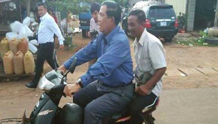कंबोडियाच्या पंतप्रधानांना बिना हेल्मेट बाईक चालविल्याने दंड