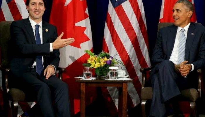 बराक ओबामा यांनी पीएमच्या पत्नीचा हात पकडल्याने वाद