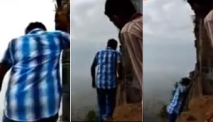 VIDEO: मंदिराभोवती प्रदक्षिणा घालताना तरुण दरीत कोसळला